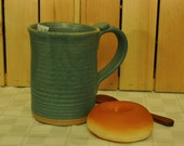 """Stoneware Pottery Mug with Cerulean Matte Glaze. 4-1/4"""" tall x 3-1/2"""" dia. Holds 16 ounces of your favorite beverage."""