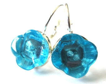 Antique button earrings. Glass flower shape earrings, 2-hole style, aqua blue glass with silver leverbacks