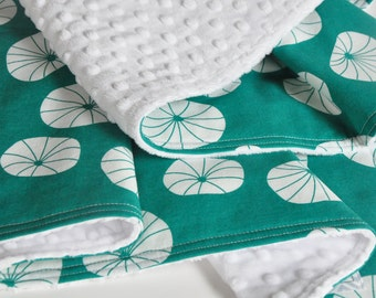 Baby Blanket, Floating Axes on turquoise