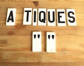 Antique porcelain tile letters