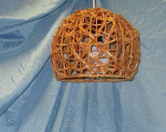 Re-purposed basket, Caramel color, hanging, pendant lighting, eco friendly, upcycled, recycled, repurposed