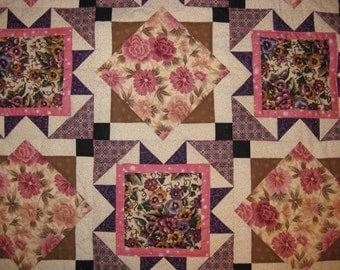 Quilted Wall hanging in Purple and Mauve colors