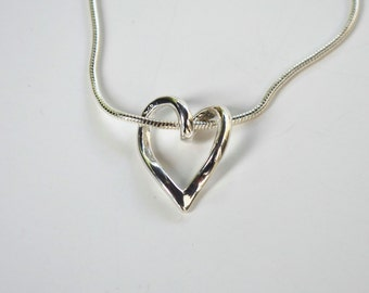 Short necklace with sterling silver heart pendant.