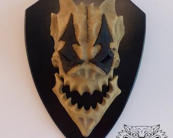 Harlequin Skull Trophy - small
