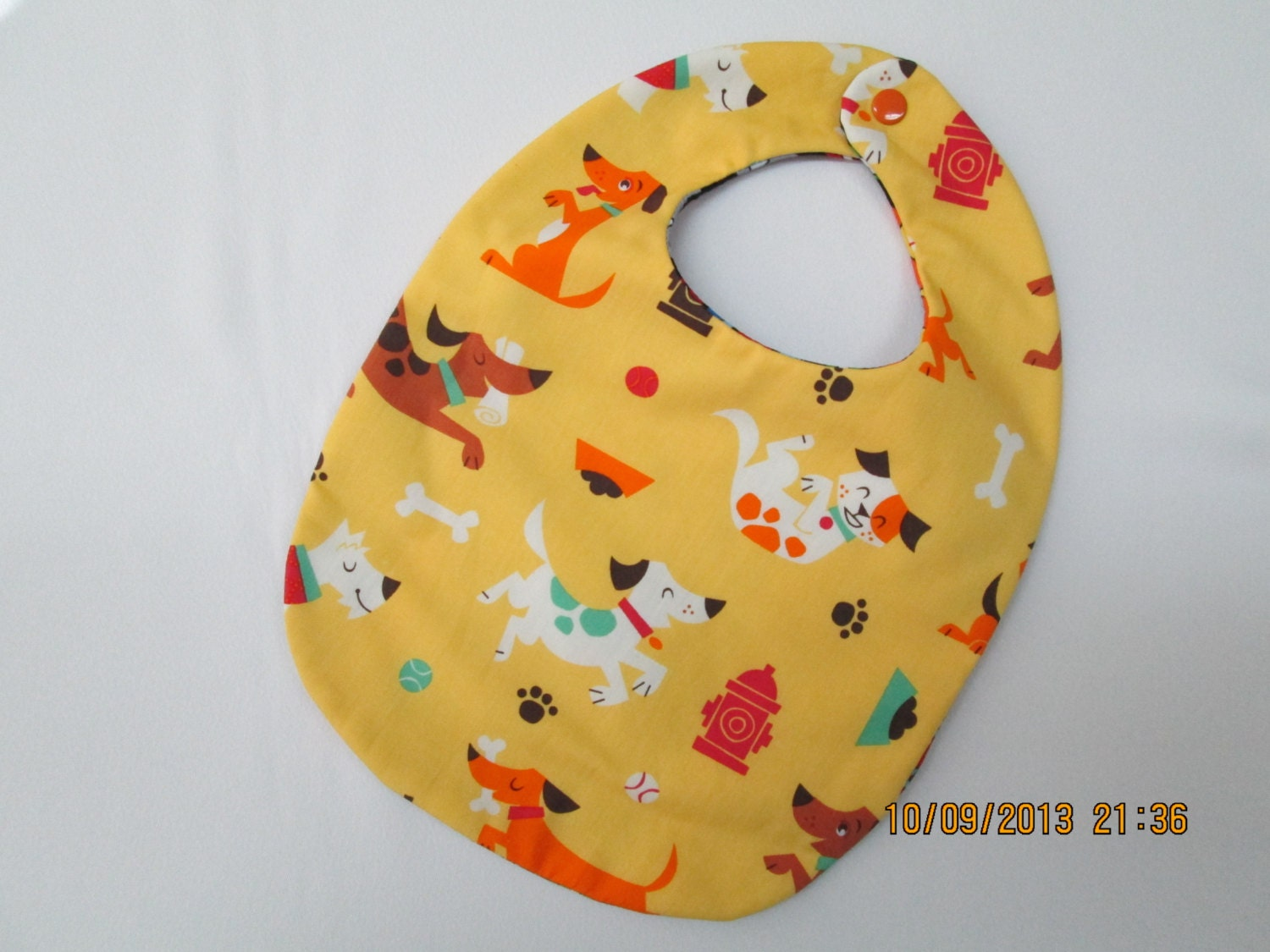Baby bib in dog themed fabric for Baby themed fabric