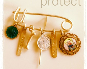 Protect pin badge with religious charms