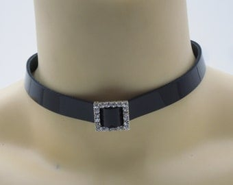 Black leather choker with a rhinestone focal point