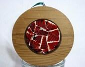 Western red cedar round filled with crushed, vintage, black cherry tableware.