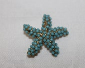 Starfish brooch with tiny turquoise beads covering the whole star fish