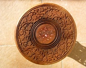 Hand carved round wooden table with floral design