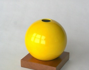 bright yellow ceramic vase with solid cherry base
