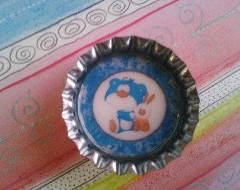 Blue bear with bunny bottlecap magnet