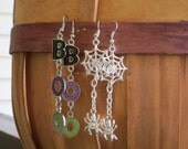 Halloween Earrings. Set of 2 - BOO in black, purple and green letters and a silver spider web with dangling spider.  On silvertone fishhooks