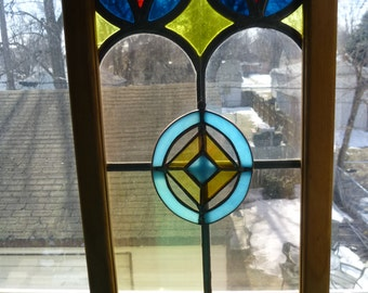 Lovely 2 piece wood framed stained glass panel - matching dangle attached to frame and centered upon the crosspiece