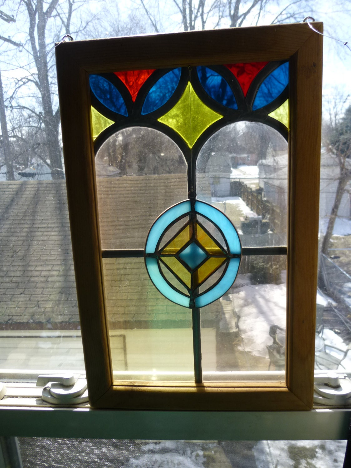 lovely 2 wood framed stained glass panel matching