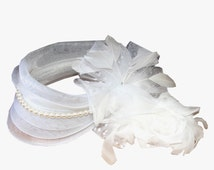 White Fascinator with tulle and pearls, accented with feather