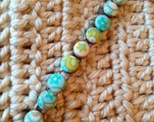 Fabric covered floral ocean button bracelet