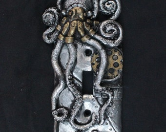 Steampunk Octopus Switch Cover. silver and gold patina, wall art sculpture home decor.