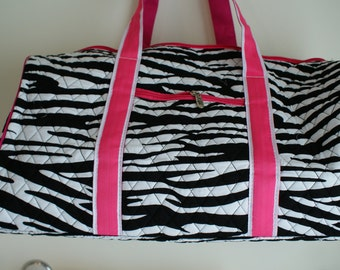 personalized zebra quilted duffle bag with hot pink accents