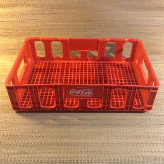 A Single Red Plastic Coca Cola Crate Tote Tray Box Has The
