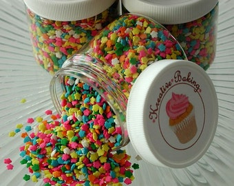 Mini Flower Sprinkles-Mini Flower shaped Quins can be used to decorate your cakes, cupcakes, cookies and brownies. 4 oz Container