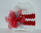Baby girl knitted white hat with red stripes and emovable flower