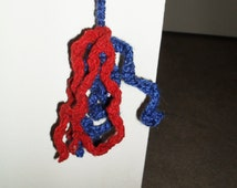 Hand crocheted yarn dangling cat toy. Hang it from the doorknob for hours of kitty fun! Choose blue and red or pink and grey.
