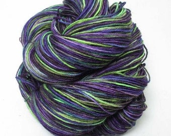 Hand Painted Sock Yarn.  Superwash BFL, Nylon. 4 ply. Purple, dark blue, chartreuse