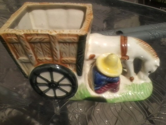 Darling ceramic horse drawn cart with man and his sombrero, taking a rest. This is 50's Made in Japan Planter in Excellent Condition.