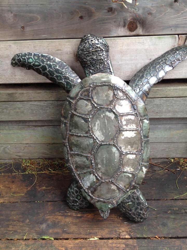 Metal sculpture of sea turtle