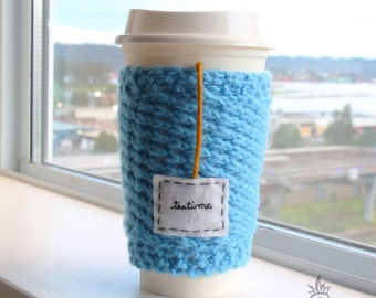 "Blue Knitted Travel Mug Cozy,  Coffee Cozy, Cup Cozy, Coffee Sleeve, Tea Cosy with Embroidered Felt Tag, ""teatime"""