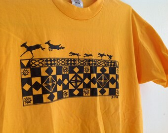 T-Shirt Yellow/ Marigold with Black Geometric Tribal Design with Gazelles - size large