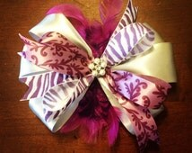 Plum and purple zebra print, feather baby bow