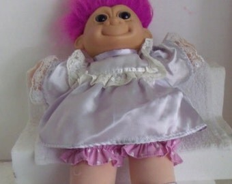 Sale ............VINTAGE/NEW Old Store StockTROLL Doll/ Wearing Lavender Party Dress/ Fuschia Hair