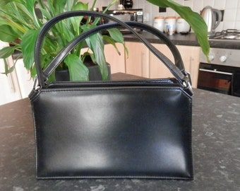 Black handbag from Clubhouse designed by Jane Shilton