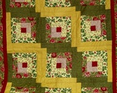"""50"""" x 60""""  Log cabin quilt, handmade, colorful, red hearth square, yellow and green with solid red backing with a red border 190.00"""