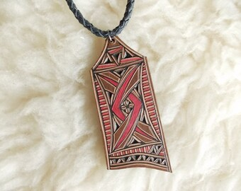 Carved leather pendant - leather jewelry