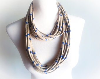 From casual to dressy.  The perfect accessory for all seasons. This multi-strand infinity scarf is handmade