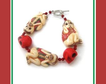 Hear No Evil: carved bone bracelet and earrings