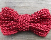 Red beaded bow on brooch pin, hand knitted