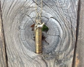 Pendant made with an etched 303 calibre brass bullet casing.