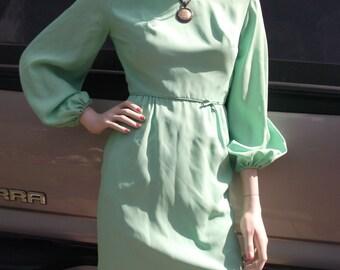 Pastel green dress with long puffed sleeves, boat neckline, metal back zipper, waist bowtie, lined dress,elastic cuffs, vintage pencil dress