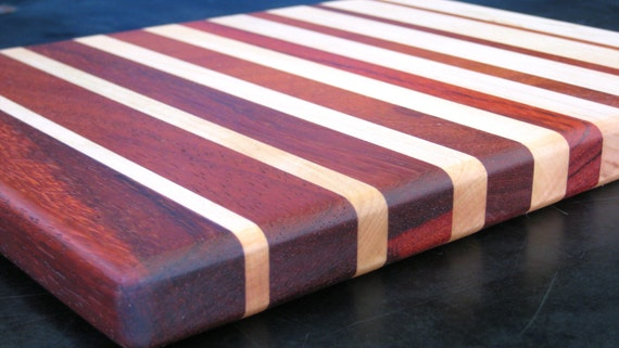 Padauk and maple cutting board fading stripes