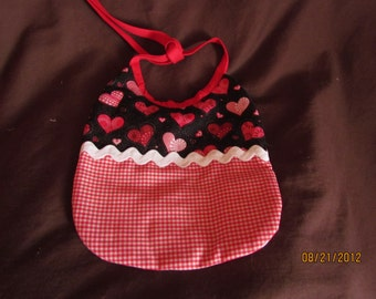 red and black heart baby bib