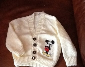 Hand knitted baby cardigan with Mickey Mouse embroidery