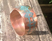 Hand hammered copper bracelet, with etched motif.
