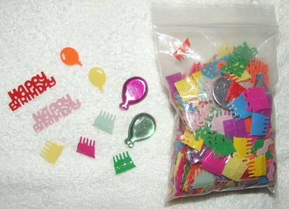 Cute little birthday scrap booking items balloons and embellishments