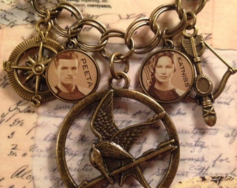 """SALE Hunger Games Catching Fire Necklace on a 20"""" brass chain. Katniss, Peeta and the Catching Fire Medallion"""