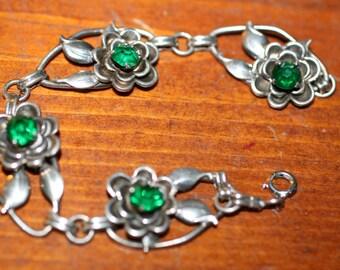 A Vintage Harry Iskin sterling and blue stone 7'' floral bracelet
