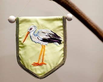 Birthcard with embroidered stork